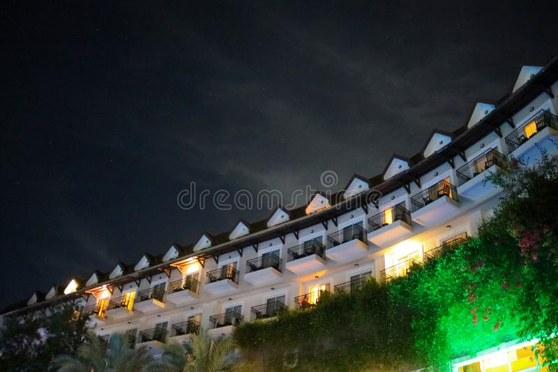 Travel night building lights roof sky. Sky rest travel night building lights resort night scenes delight roof balconies royalty free stock image