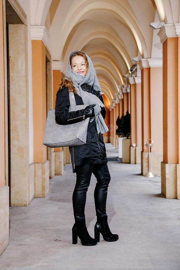 Travel the old city. A young woman travels. Market Square in Warsaw. Curly girl walks through the streets of the city. Poland stock image