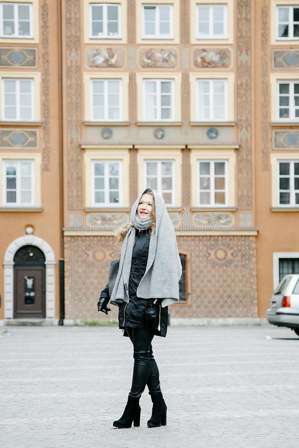 Travel the old city. A young woman travels. Market Square in Warsaw. Curly girl walks through the streets of the city. Poland stock photos