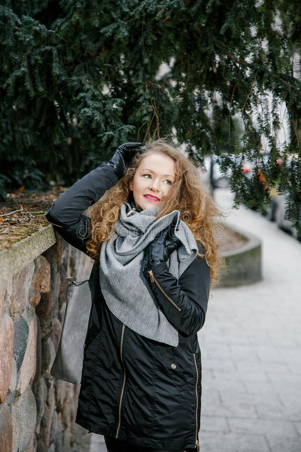 Travel the old city. A young woman travels. Market Square in Warsaw. Curly girl walks through the streets of the city. Poland royalty free stock photos