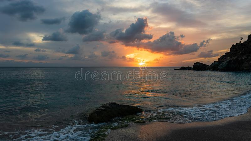 Travel photo of St. Barth's Island St. Bart's Island, Caribbean. View of a peaceful sunset and waves on Shell Beach.  stock images