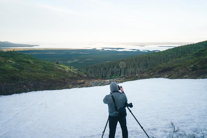 Photographer is Shooting in the Mountains stock images