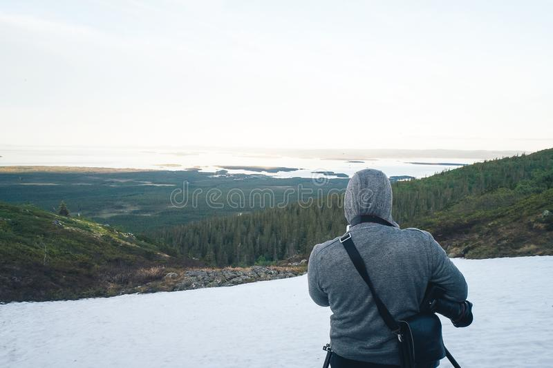 Photographer is Shooting in the Mountains stock photos