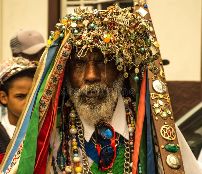 Travel photography - Afro american man dress in a ritual way for religious party in his city royalty free stock image