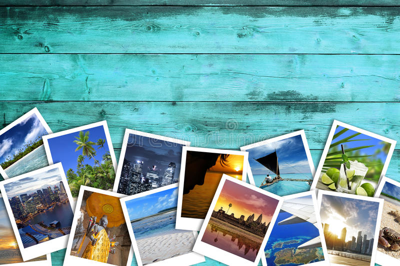 Travel photos on turquoise wood background stock images
