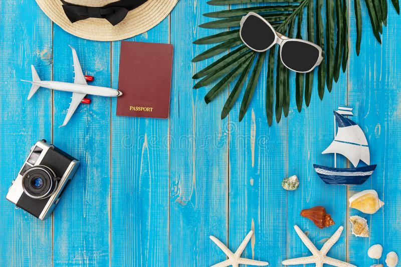 Travel Plan. Traveler planning trips summer vacations on the beach with Traveler`s accessories, retro camera, sunblock, sunglasse stock photos