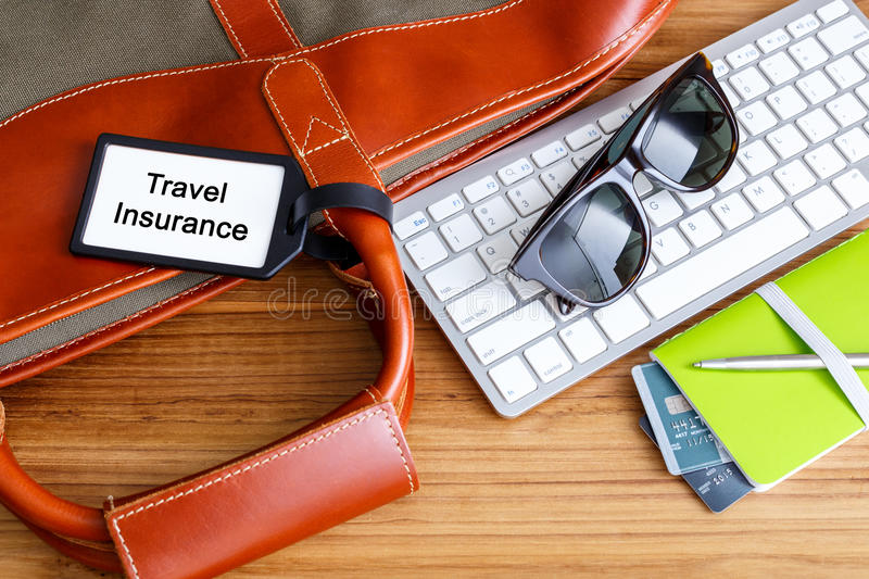 Travel planning with travel insurance tag. Travel booking and planning concept with travel insurance tag and credit card stock photo