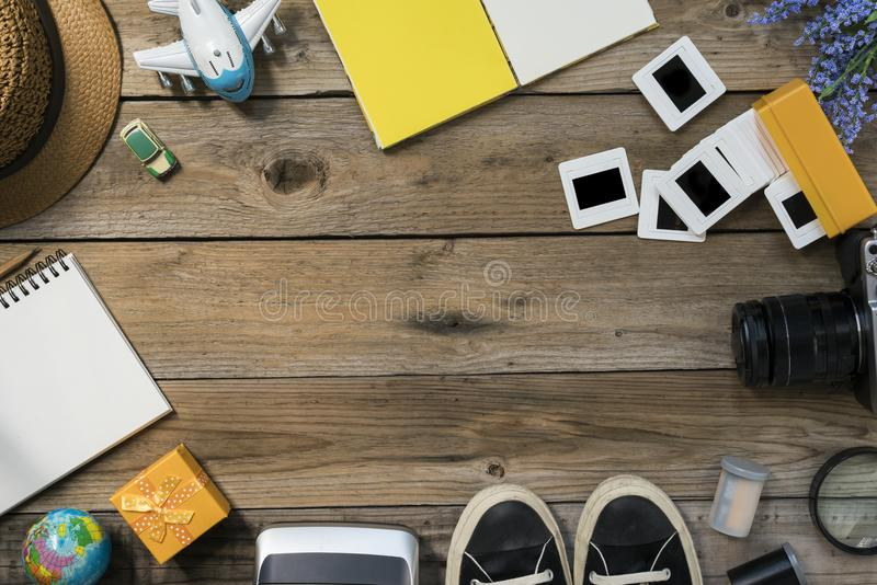 Travel planning on wooden background. Top view stock photography