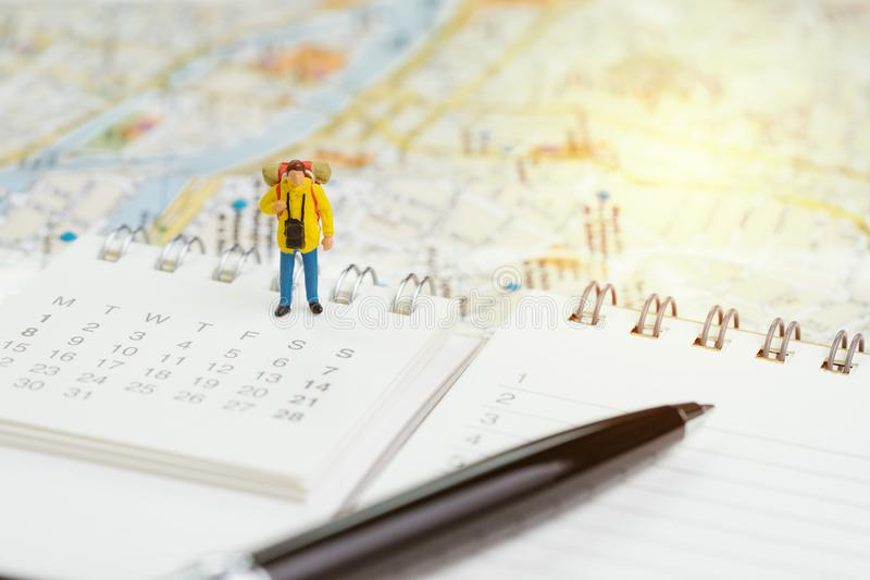 Travel planning or year plan for vacation or start new journey concept, miniature people traveller, backpacker man standing on royalty free stock images