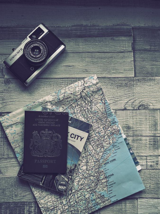 Travel plans with Olympus Trip camera passport and East Coast USA map  vintage filter. Travel plans with vintage Olympus camera passport and map of East Coast stock image