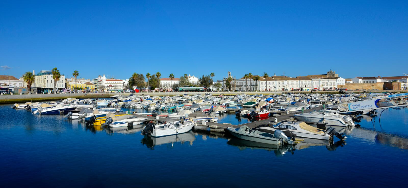 Travel Portugal, Faro Dock and Harbor, Downtown Historical Buildings, Medieval Wall. April, 2018: Faro`s dock and seafront historical buildings and medieval wall royalty free stock photo