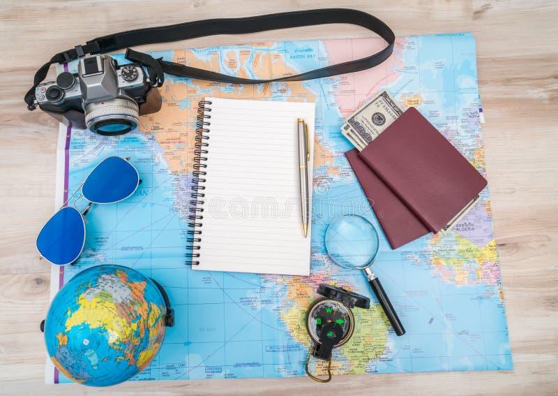 Travel preparation : compass, money, passport, road map ,sunglasses,magnifying glass ,camera ,cloth ,book on wooden table . Travel preparation : compass, money royalty free stock photos