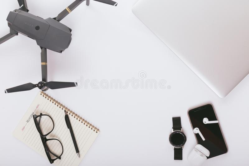 Travel preparations essentials for trip white wooden table background. flat lay stock image