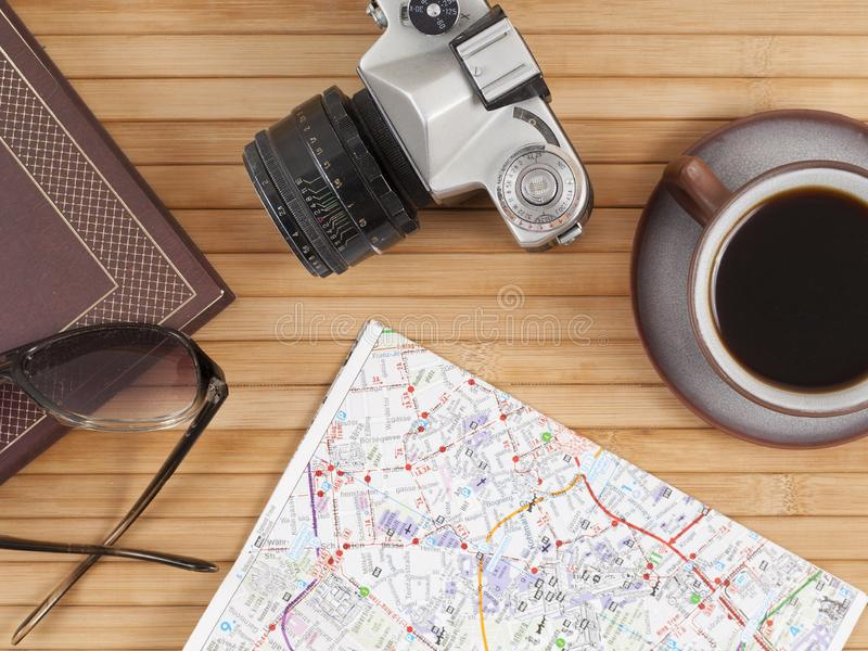 Travel preparations essentials world map cup of coffee vintage film camera notebook royalty free stock photo