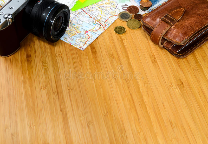 Travel preparations. Getting ready for travel, money, map and photo camera on wooden table with copy space stock photography