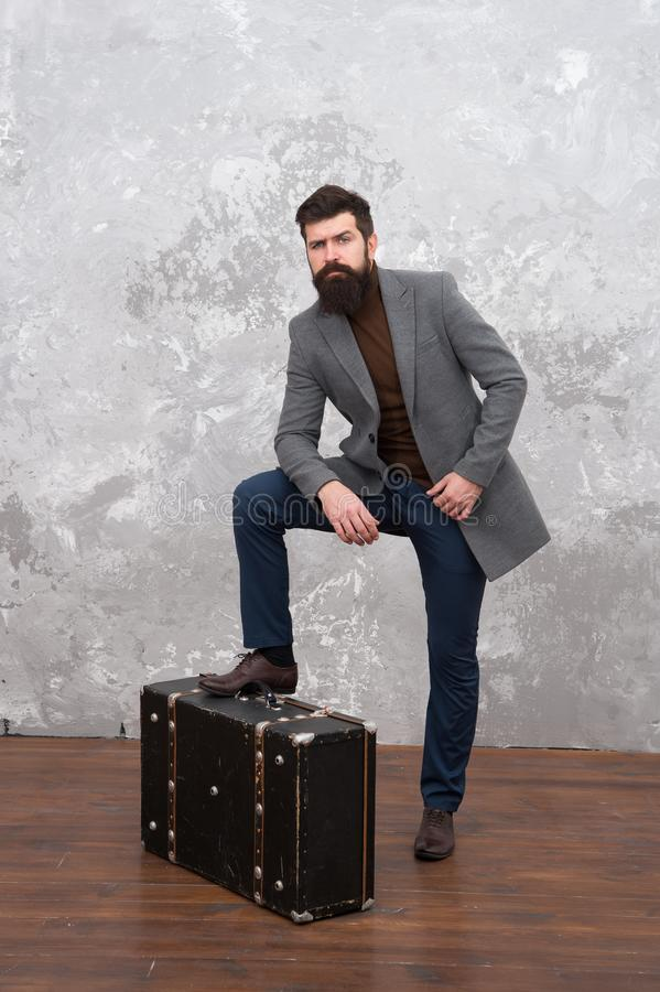 Travel and relocation. Man well groomed bearded hipster big suitcase. Travel and baggage concept. Hipster traveler with. Baggage. Ready for relocation with stock images