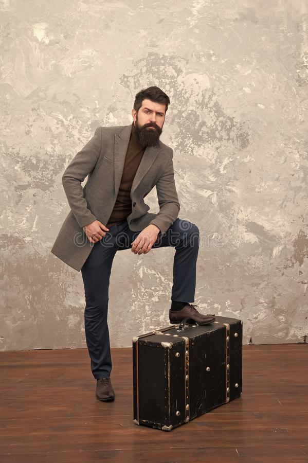 Travel and relocation. Man well groomed bearded hipster big suitcase. Travel and baggage concept. Hipster traveler with. Baggage. Ready for relocation with royalty free stock photo