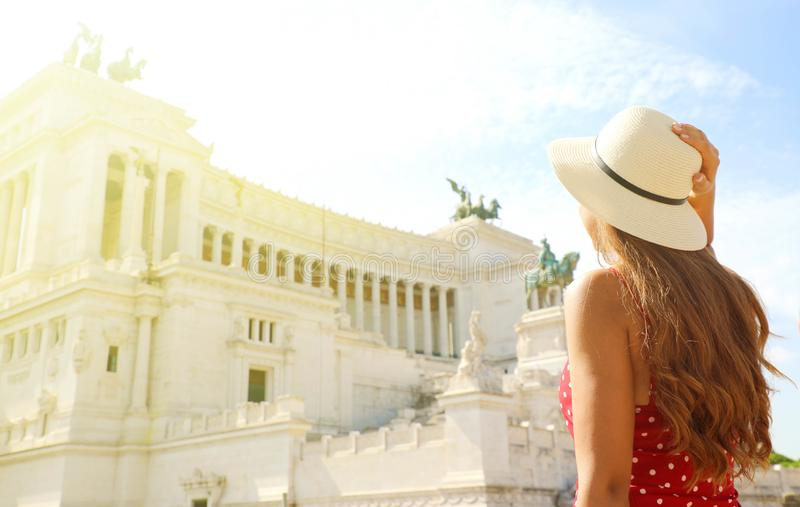 Travel in Rome. Back view of beautiful girl visiting Altar of the Fatherland famous landmark of Rome. Summer holidays in Italy stock photos