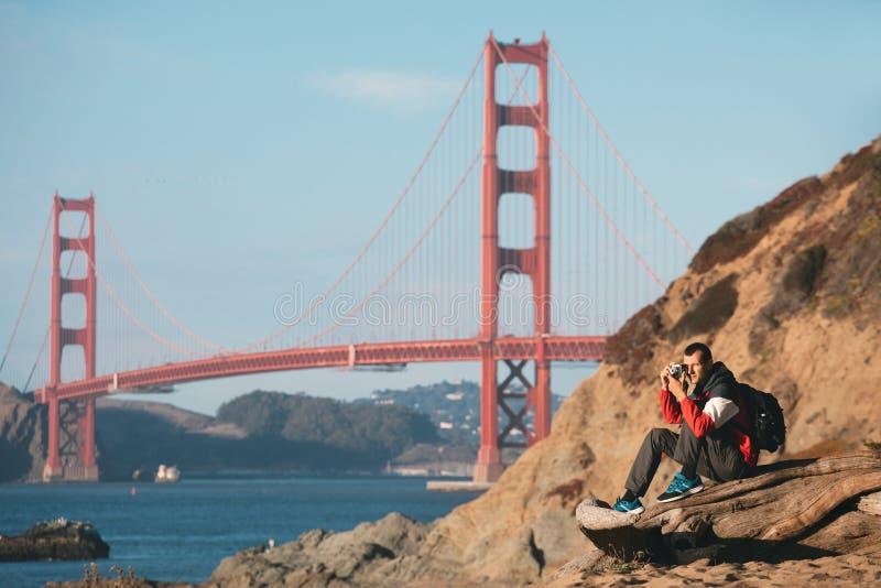 Travel in San Francisco, tourist man with camera in front of Golden Gate Bridge, San Francisco, California, USA stock photos