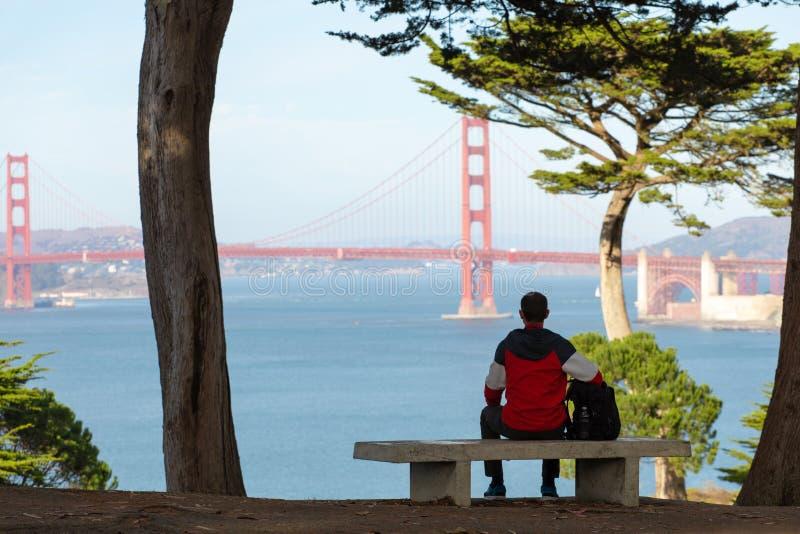 Travel in San Francisco, tourist man enjoying the view of Golden Gate Bridge, San Francisco, California, USA.  stock photos