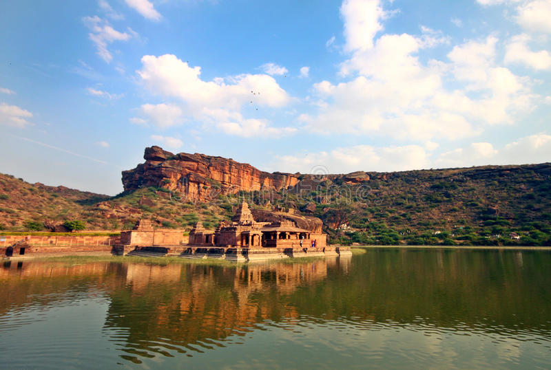 Travel shot of acient Badami temple in lake royalty free stock photo