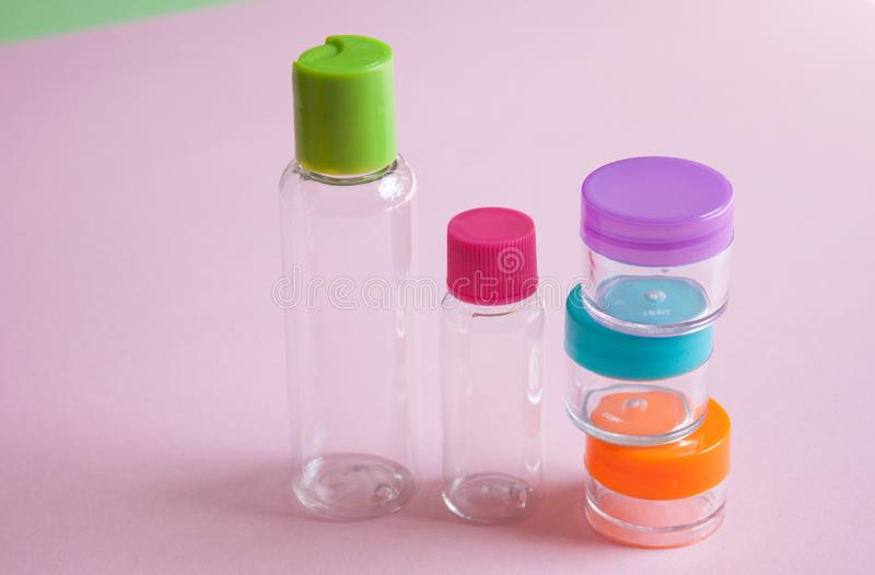 Travel size cosmetic and creams containers set royalty free stock image