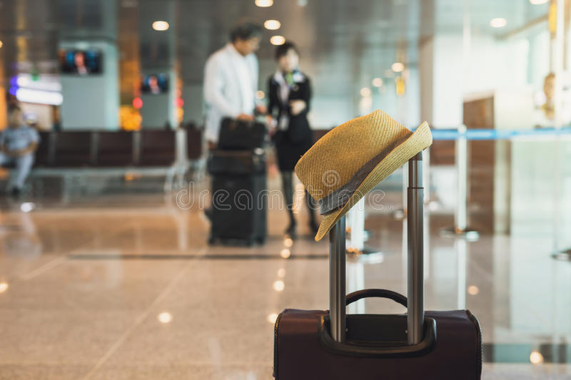 Travel suitcase in airport terminal. And passenger background royalty free stock images