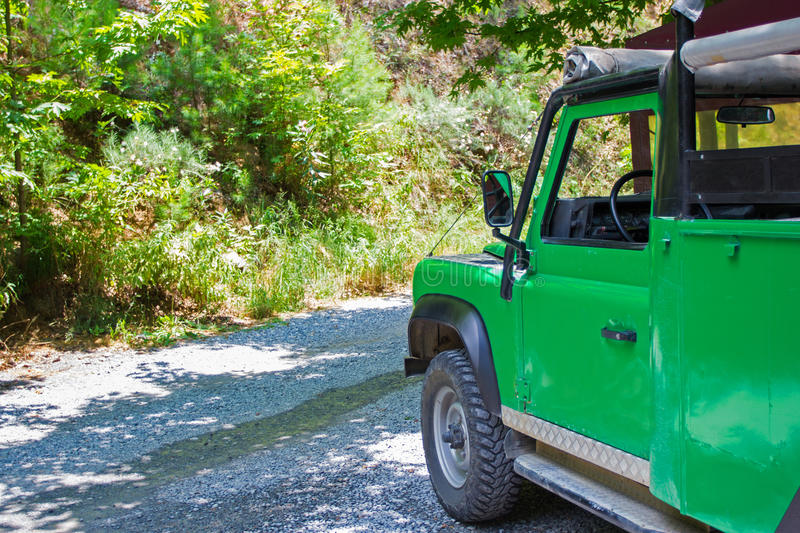 Travel and summer activity concept - safari car in forest royalty free stock photos