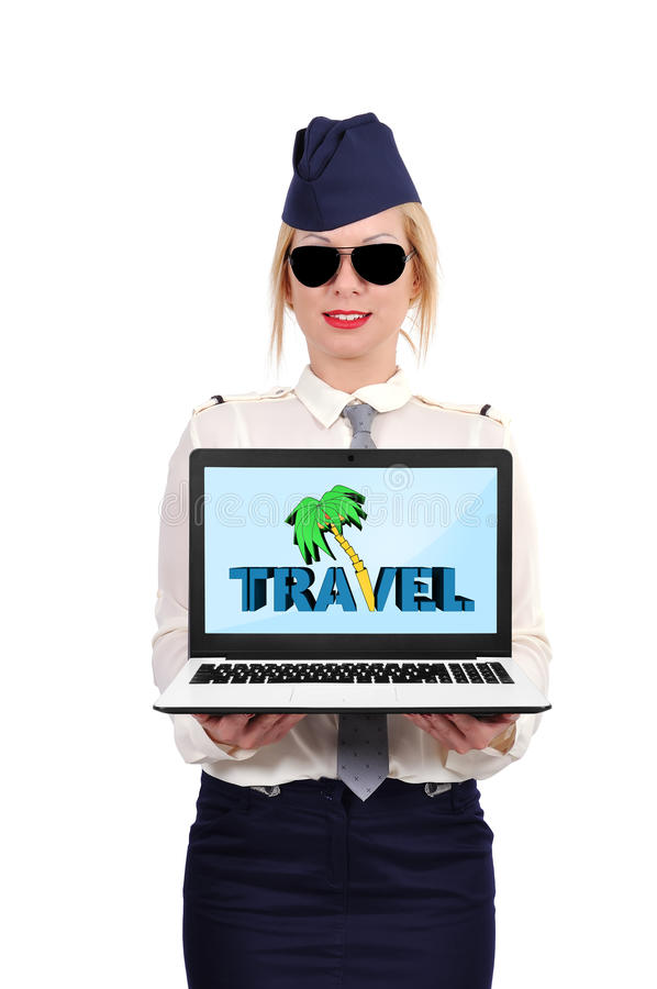 Travel symbol. Flight attendant holding laptop with travel symbol stock photo