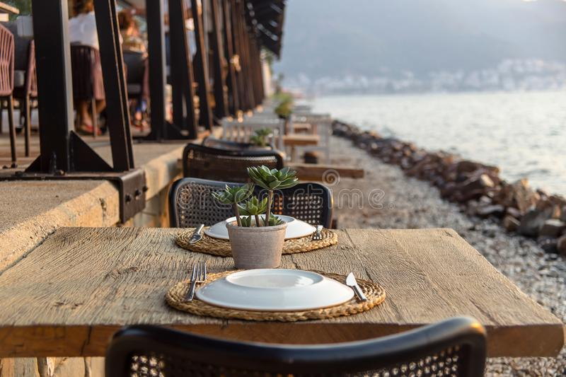 Travel table for lunch or dinner by the sea stock image