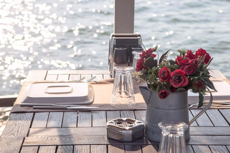 Travel table for lunch or dinner by the sea royalty free stock image