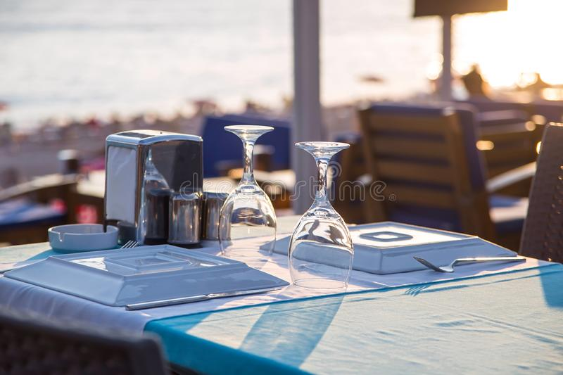 Travel table for lunch or dinner by the sea royalty free stock photos