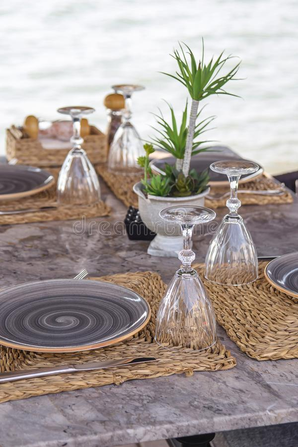 Travel table for lunch or dinner by the sea stock images