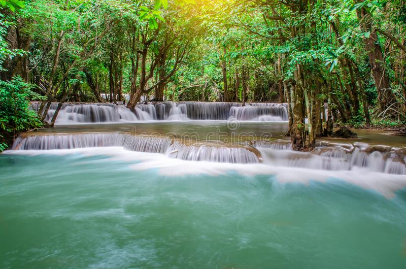 Travel to the beautiful waterfall in tropical rain forest, soft water of the stream in the natural park at Kanchanaburi, Thailand. A Travel to the beautiful stock photo