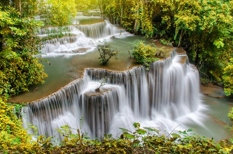 Travel to the beautiful waterfall in tropical rain forest, soft water of the stream in the natural park at Kanchanaburi, Thailand. A Travel to the beautiful stock images