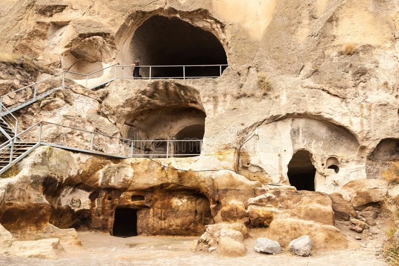 Travel to Georgia - room in artificial ancient cave city in Vardzia. Most popular georgian attraction royalty free stock photos