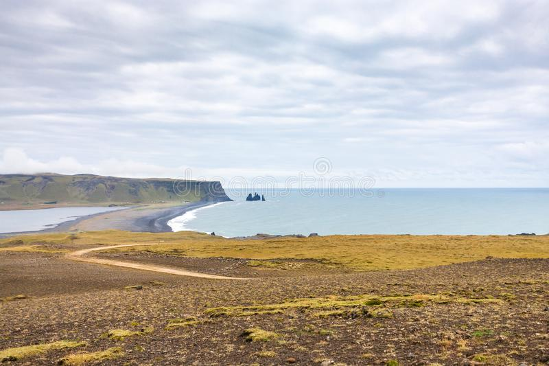 Dyrholaey promontory and volcanic beach in Iceland. Travel to Iceland - Dyrholaey promontory and volcanic beach near Vik I Myrdal village (view from Dyrholaey) stock image