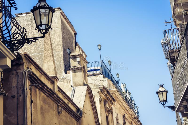 Travel to Italy - historical street of Taormina, Catania, Sicily, facade of old buildings.  royalty free stock photography