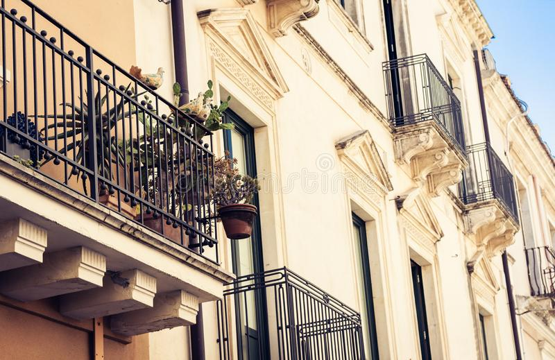 Travel to Italy - historical street of Taormina, Catania, Sicily, facade of old buildings.  stock photography