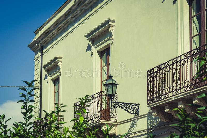 Travel to Italy - historical street of Taormina, Sicily, balcony old buildings.  royalty free stock images