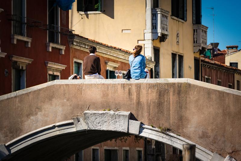 Travel to Italy. People enjoying a glass of wine on a bridge over the canal in Venice, Italy. Travel to Italy.Travel to Italy. People enjoying a glass of wine stock photography