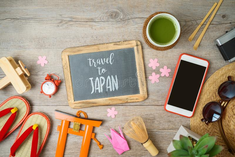 Travel  to Japan concept. Planning vacation concept with chalkboard, tourism objects and souvenirs on wooden table royalty free stock photos