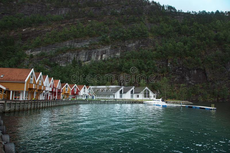 Travel to Norway, a small village on the shore of the fjord, bright houses stand in a semicircle on the waterfront stock images