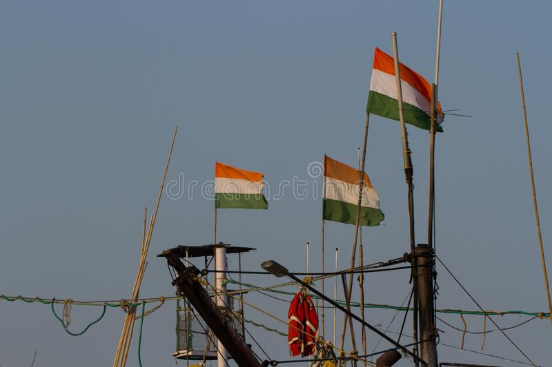 Indian flags on the masts of a fishing boat. royalty free stock images