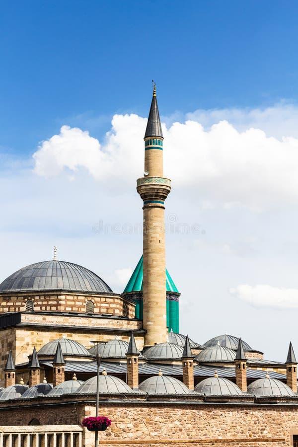Minaret and roofs of Rumi Mausoleum in Konya. Travel to Turkey - minaret and roofs of Mausoleum of Jalal ad-Din Muhammad Rumi (Mevlana) and Dervish Lodge (Tekke stock photos