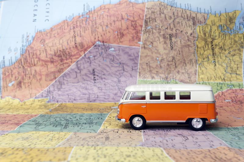 Travel to the United States of America USA. Hippie bus on the map of America. Travel concept. Travel to the United States of America USA. Road trip on Hippie bus royalty free stock image