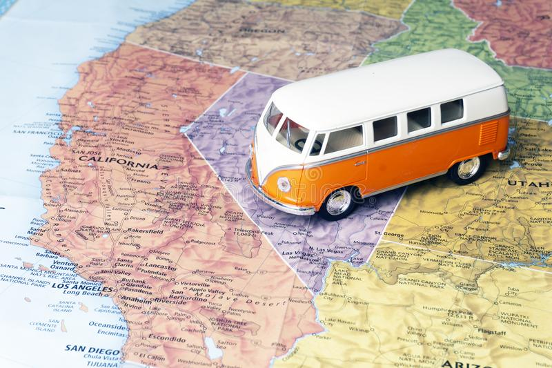 Travel to the United States of America USA. Hippie bus on the map of America. Travel concept. Travel to the United States of America USA. Road trip on Hippie bus stock photography