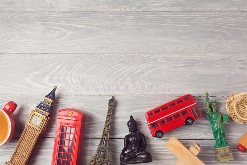 Travel and tourism background with souvenirs from around the world. View from above. stock photo