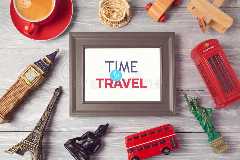 Travel and tourism concept with photo frame and souvenirs from around the world. View from above. royalty free stock images