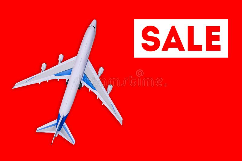 Travel and tourism concept. . Sale of air tickets and travel vouchers. Passenger aircraft on a red background. Advertising banner and discount stock photos